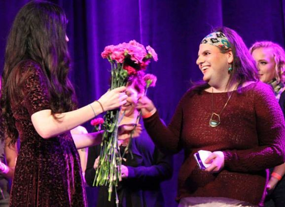 Piper receives a bouqet after a poetry performance in London, Ont.